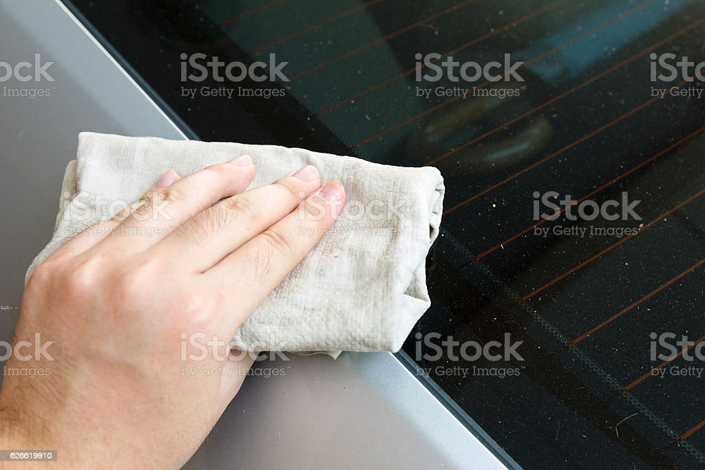 Hand cleaning car with towel. stock photo