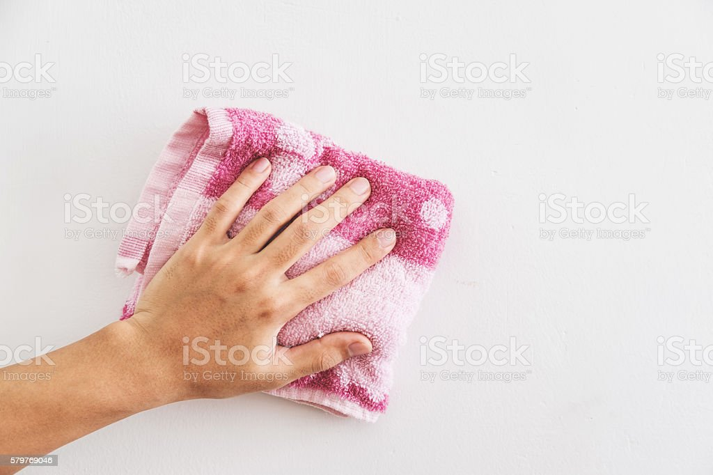 Hand cleaning white wall stock photo