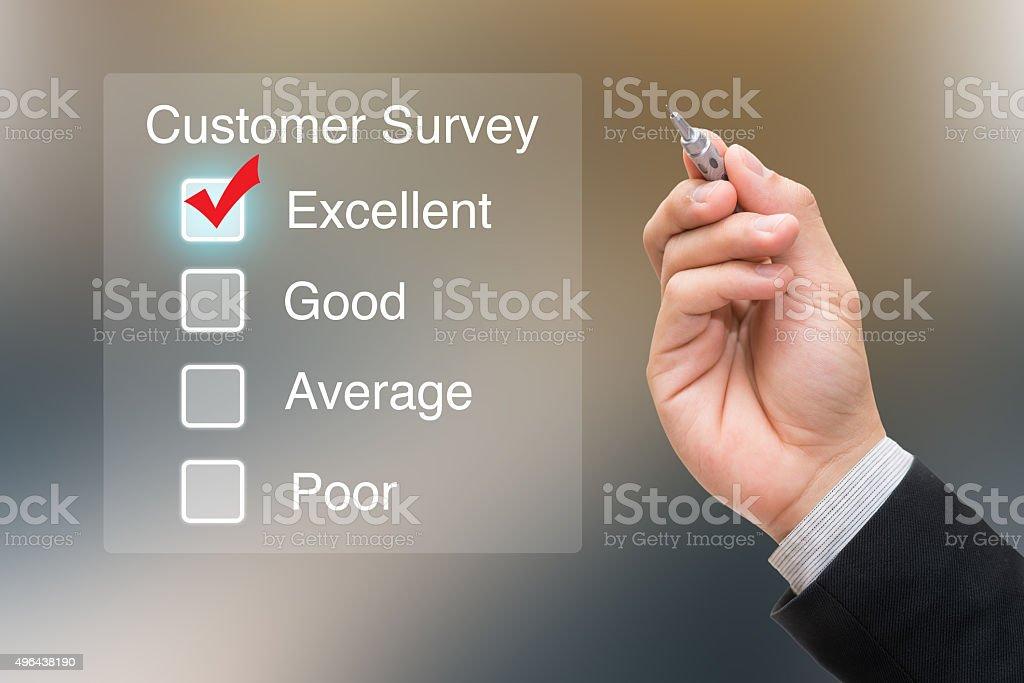 Hand clicking customer survey on virtual screen stock photo