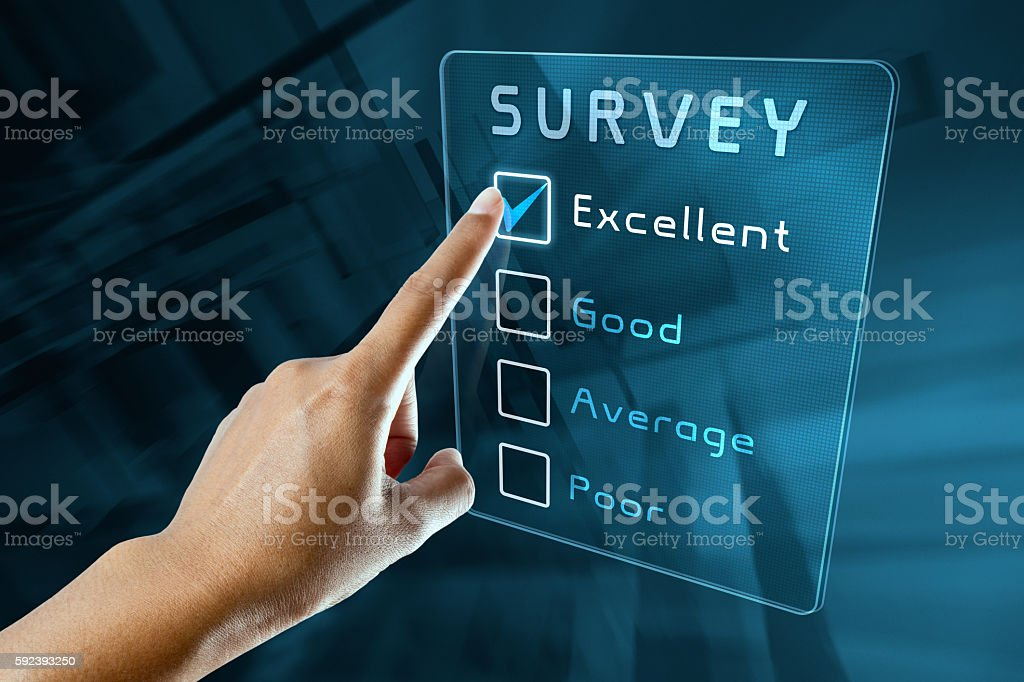 hand clicking online survey on virtual screen interface stock photo