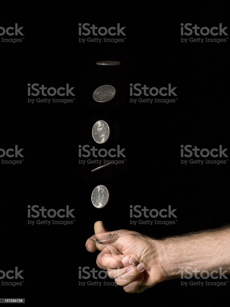 Hand Coin Toss Silver Dollar stock photo