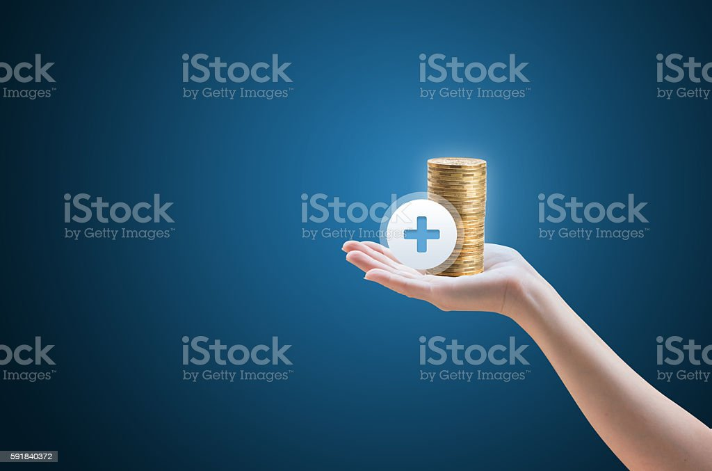 Hand coins and the icon with the plus sign stock photo