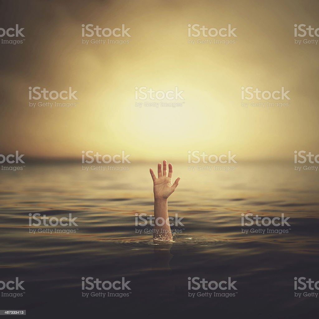 Hand coming out of the water stock photo