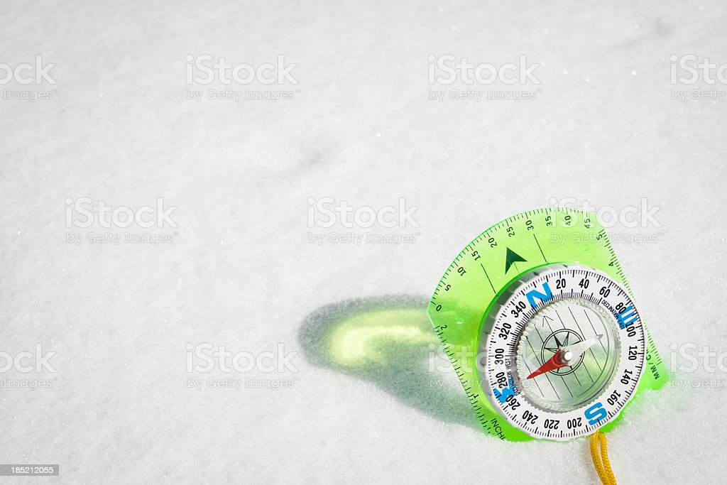 hand compass isolated in the snow royalty-free stock photo