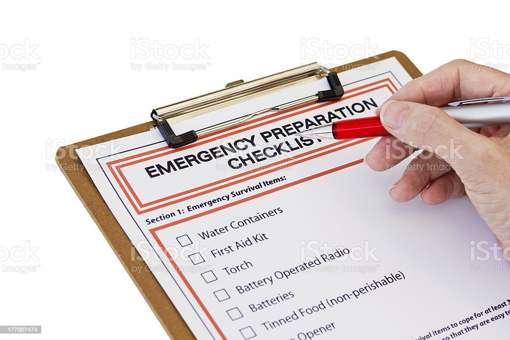 Hand completing Emergency Preparation List royalty-free stock photo