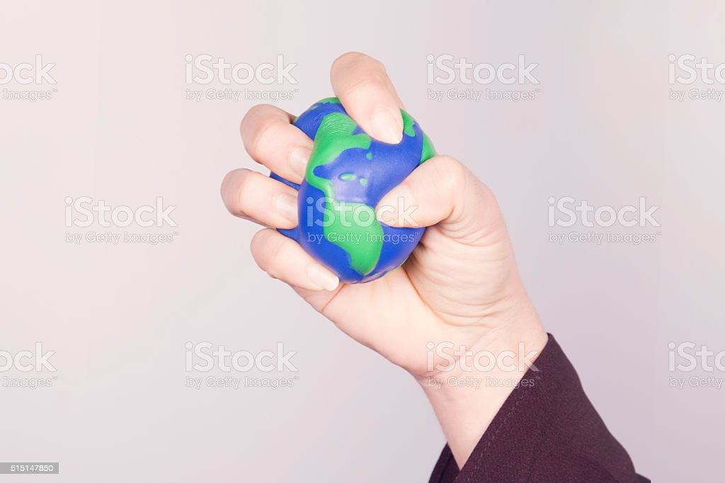 Hand compressing planet Earth. American continent. stock photo