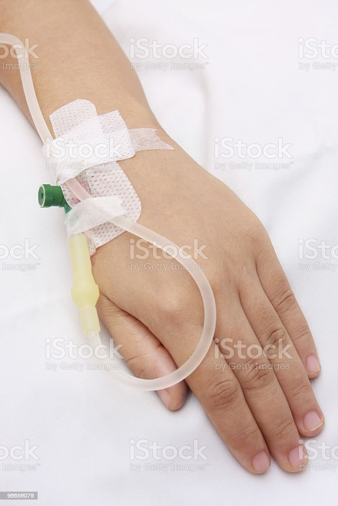 A hand connected to an IV drip royalty-free stock photo