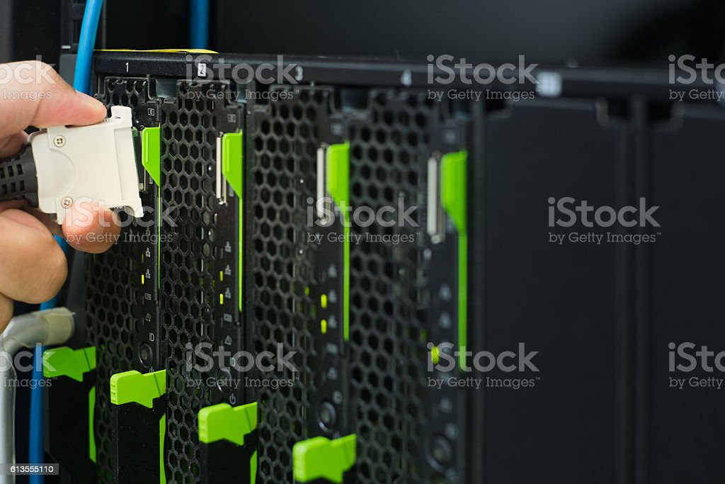 Hand connecting console to server stock photo