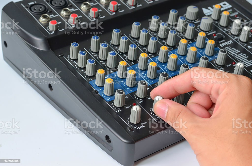 hand control vollume of mixer stock photo