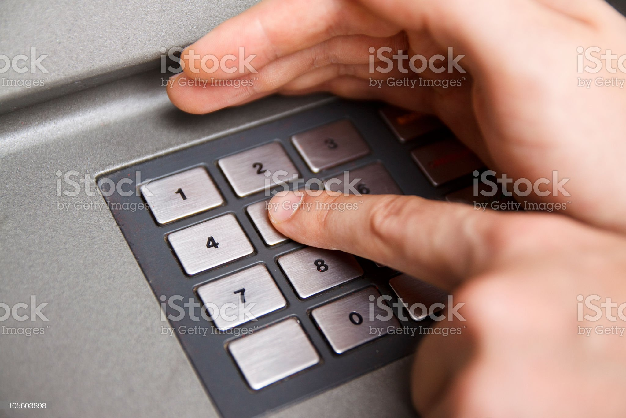 Hand Covering While Typing in a Bank Teller royalty-free stock photo
