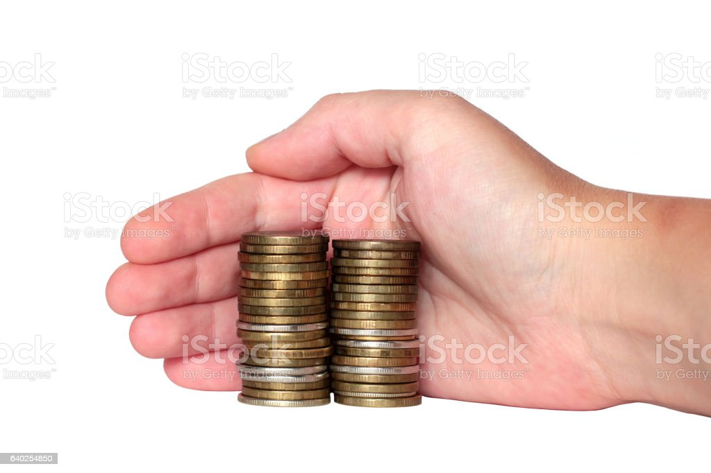 hand covers the monetary savings coins isolated stock photo
