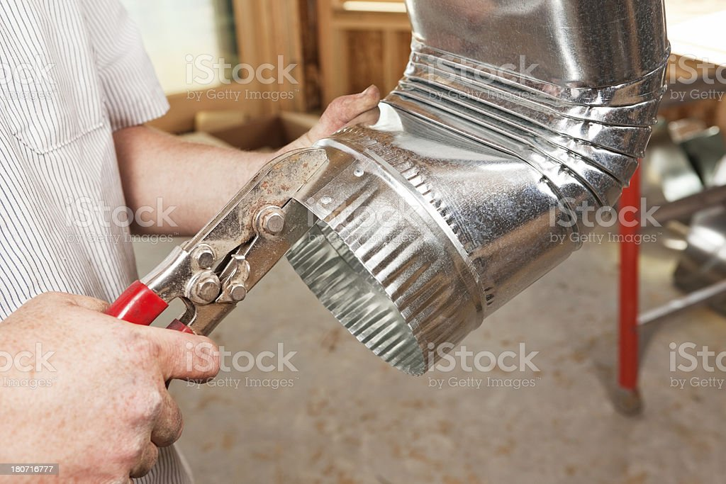 Hand Crimping Galvanized HVAC Duct Elbow stock photo