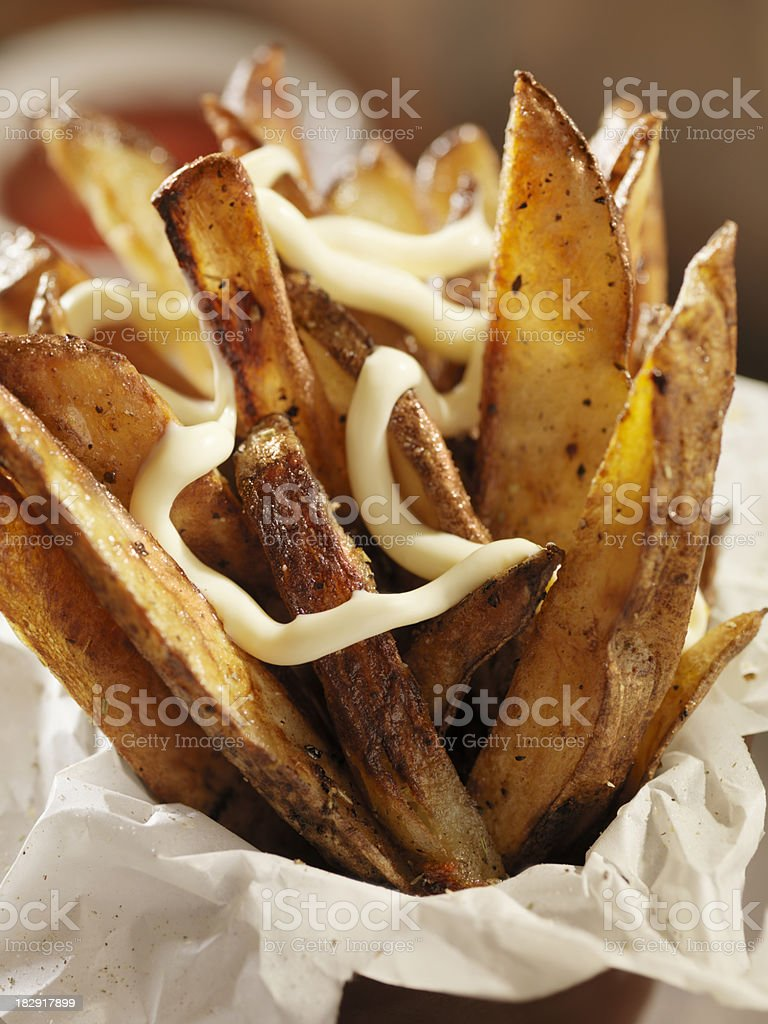 Hand Cut Oven Roasted French Fries with Garlic Mayonnaise royalty-free stock photo
