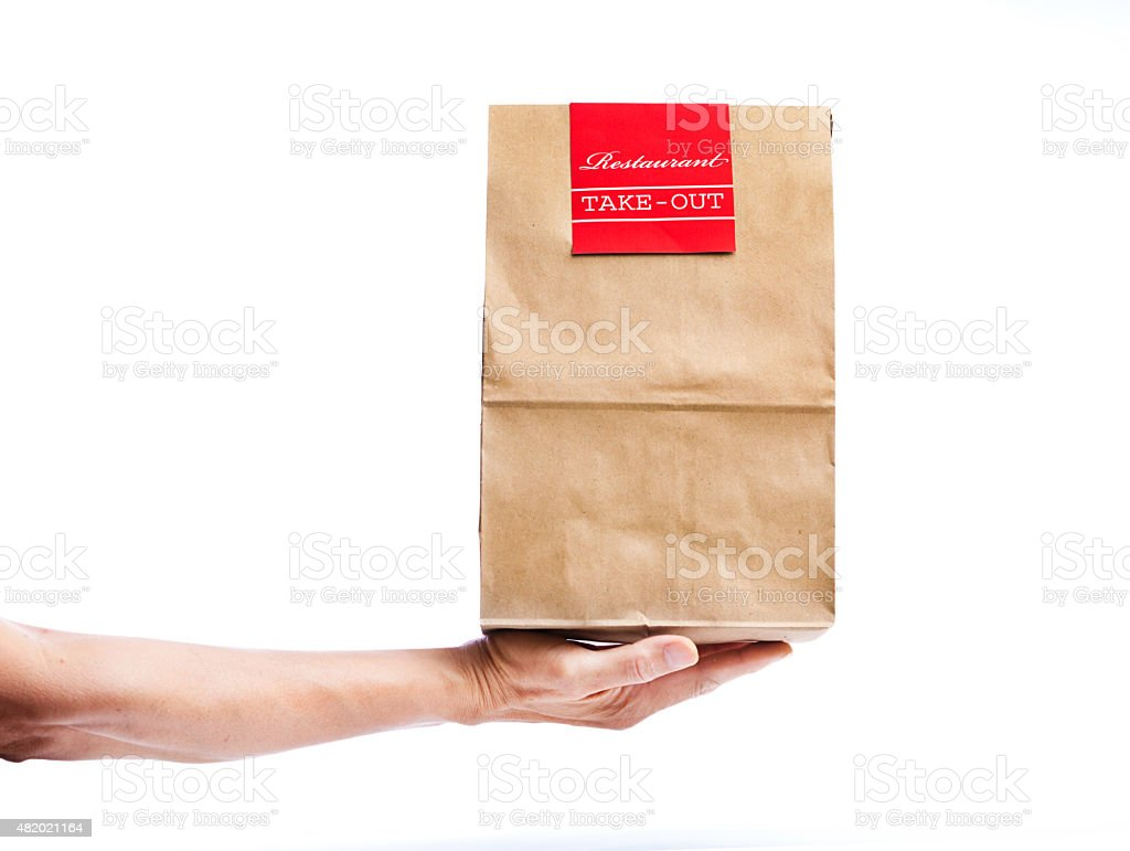 Hand Delivering Takeout Delivery Fast Food Bag Package Container stock photo