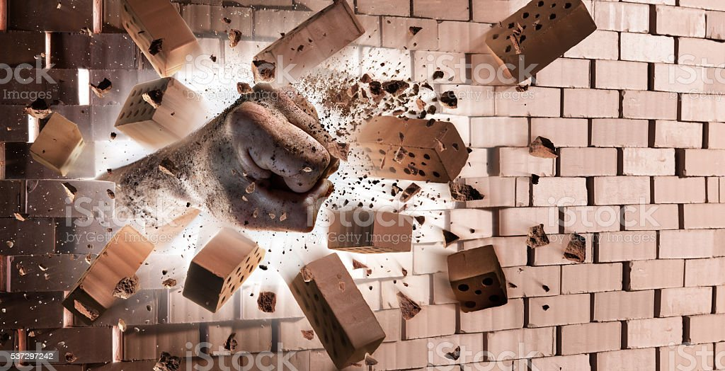 Hand Destroy Wall - Strength At Max Power stock photo