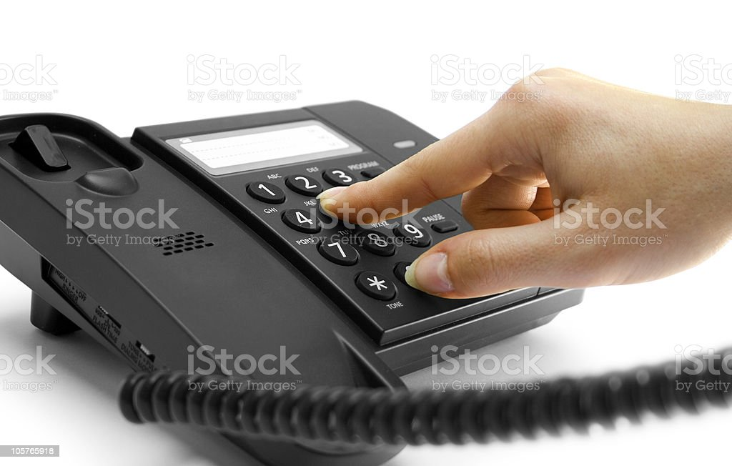 Hand dialing a number on a telephone royalty-free stock photo