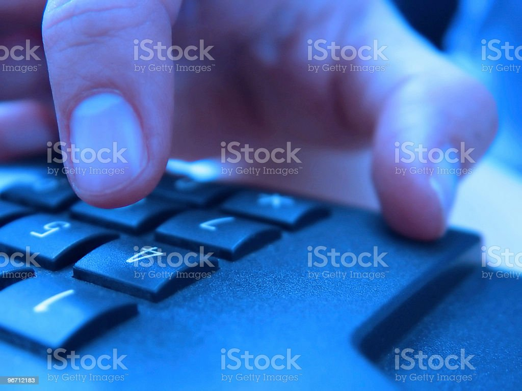 Hand dialling number on telephone, close-up royalty-free stock photo