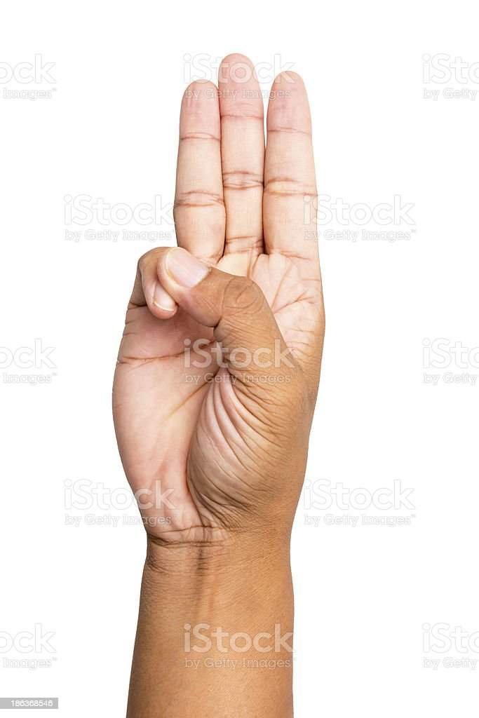 Hand doing the scout honor gesture stock photo