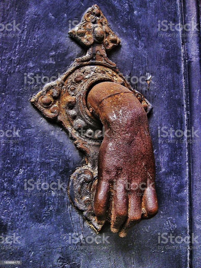 Hand door knocker. royalty-free stock photo