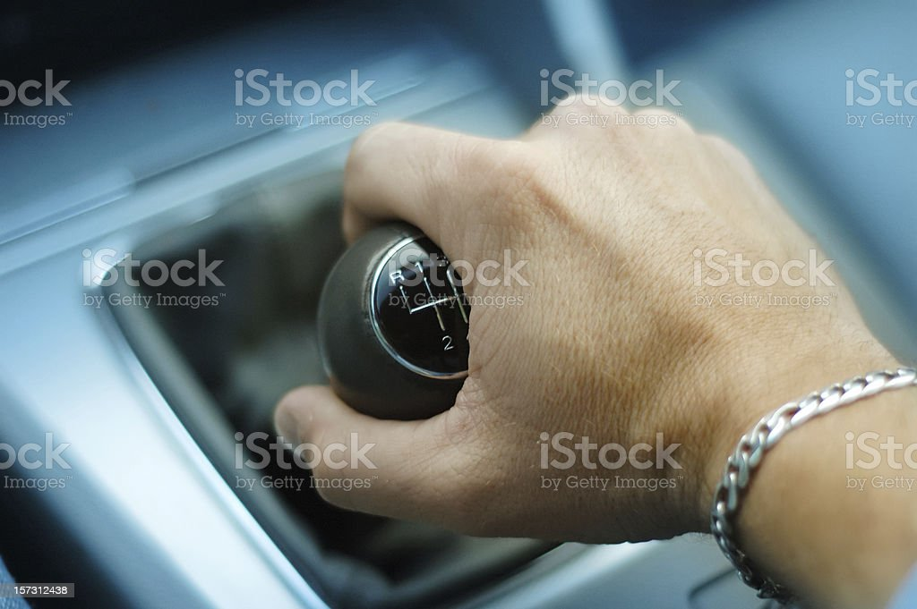Hand downshifting car five speed manual transmission stock photo