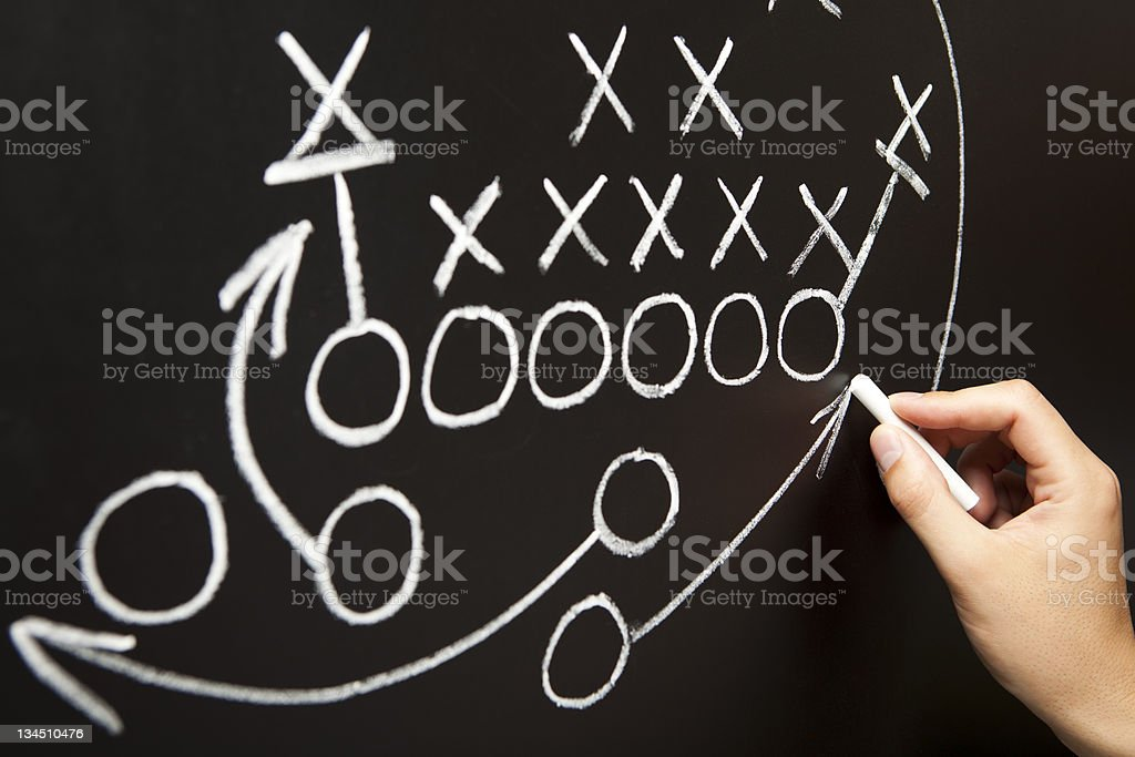 Hand drawing a game strategy stock photo