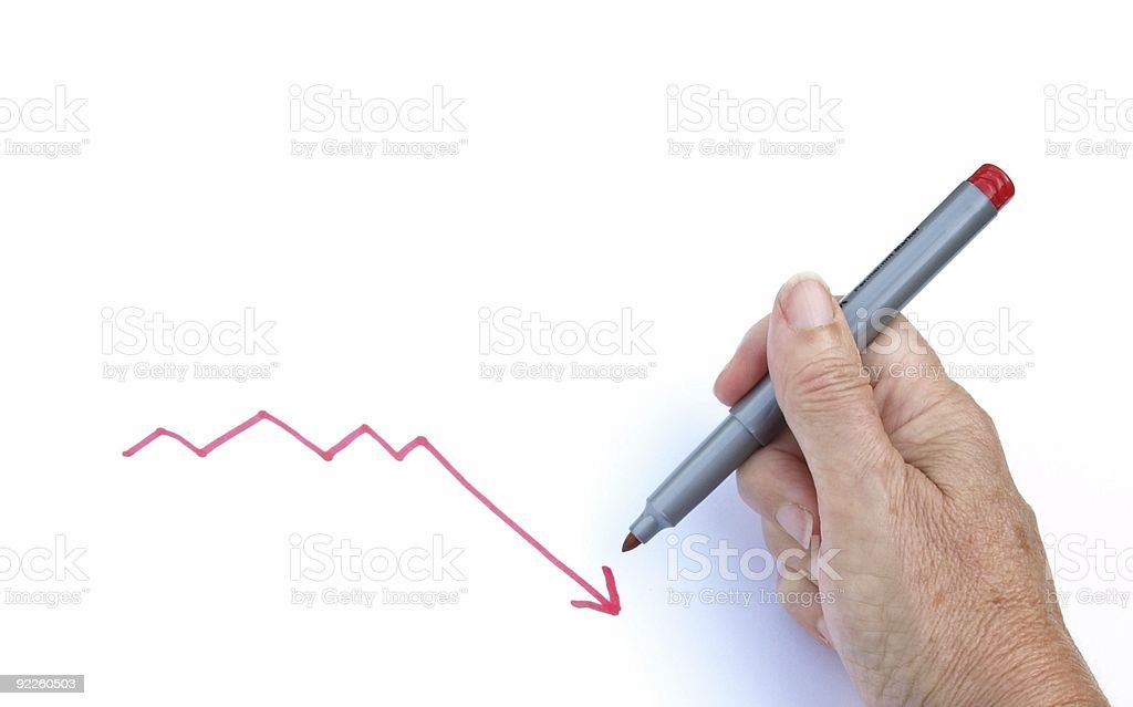 Hand drawing a graph with downward trend stock photo