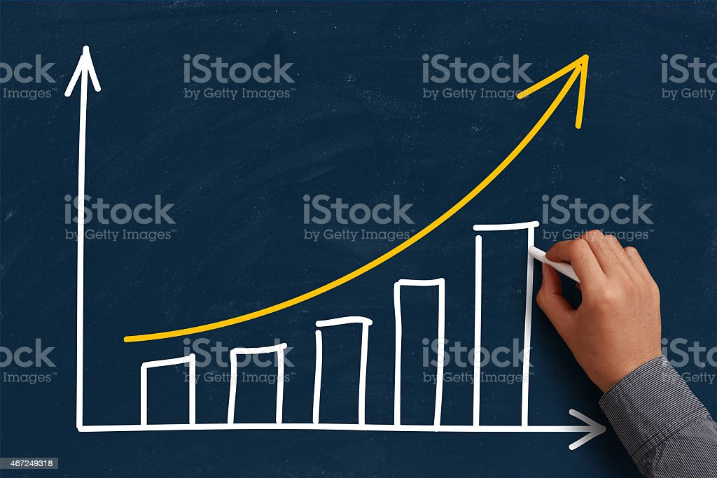 Hand drawing a growth chart on a chalkboard stock photo