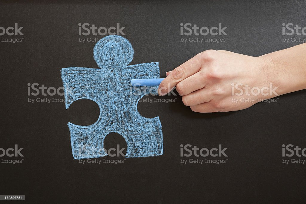 Hand Drawing Blue Puzzle Piece With Chalk stock photo