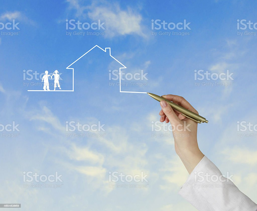 Hand drawing house and couple in the clouds stock photo