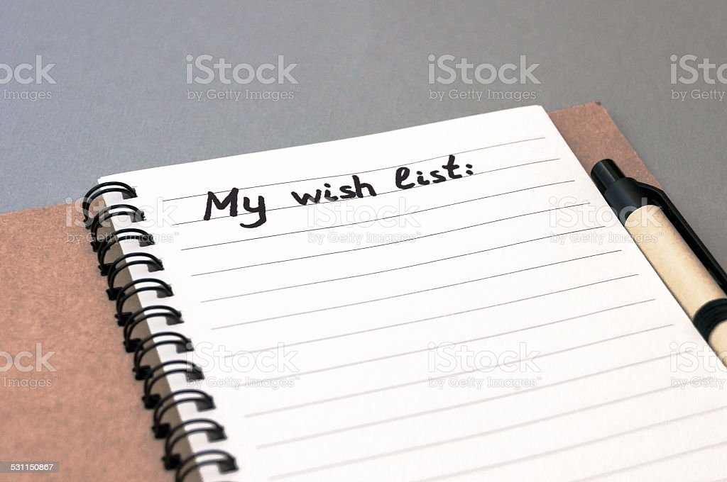 Hand drawing wish list on notebook stock photo
