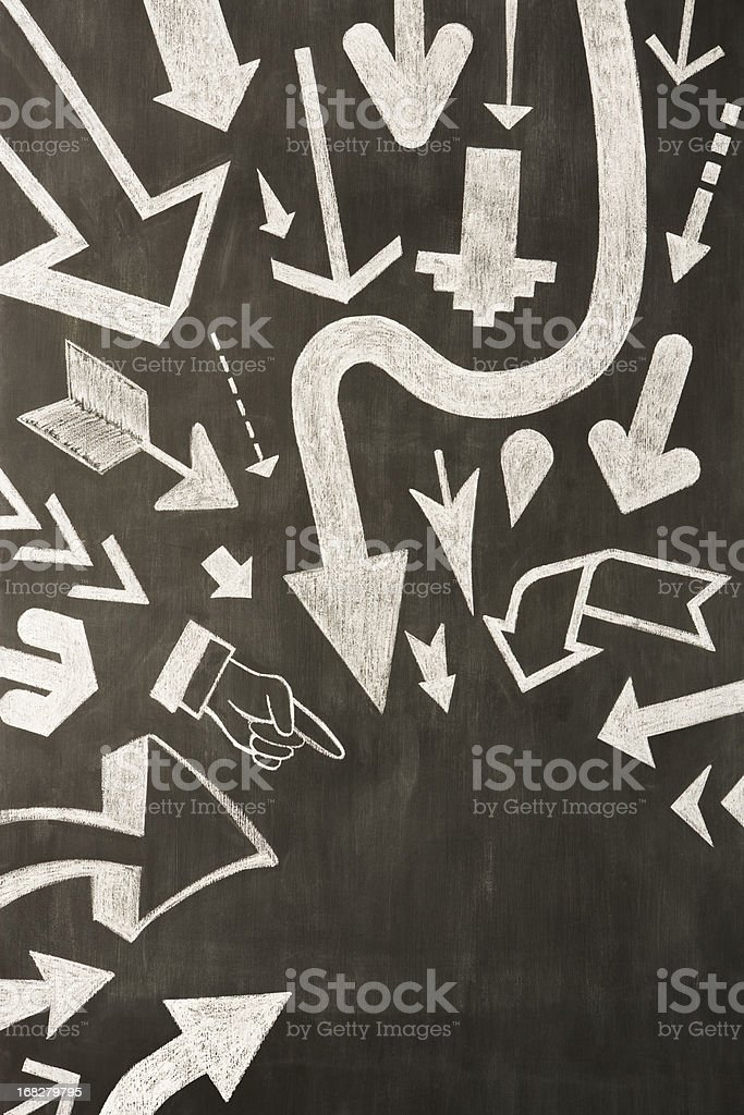 Hand drawn chalk arrows on blackboard stock photo