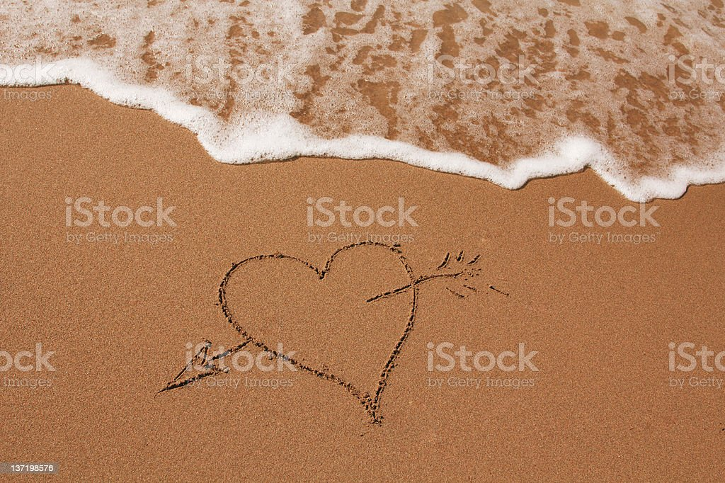 Hand drawn heart on the sand royalty-free stock photo
