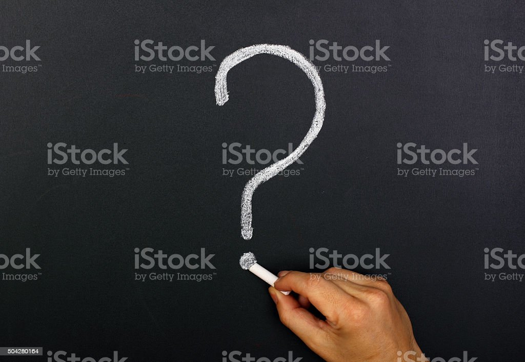 Hand draws a question mark stock photo