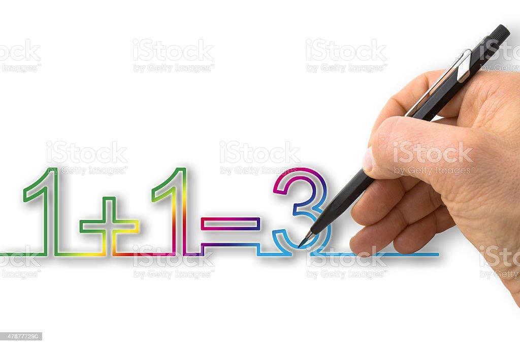Hand draws 'one plus one equals three' stock photo