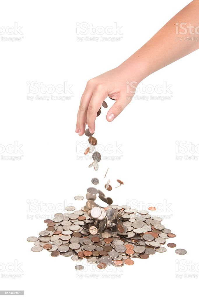 Hand dropping coins stock photo
