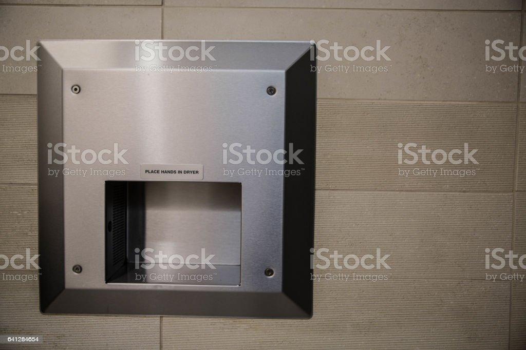 Hand Dryer on Tile Wall stock photo