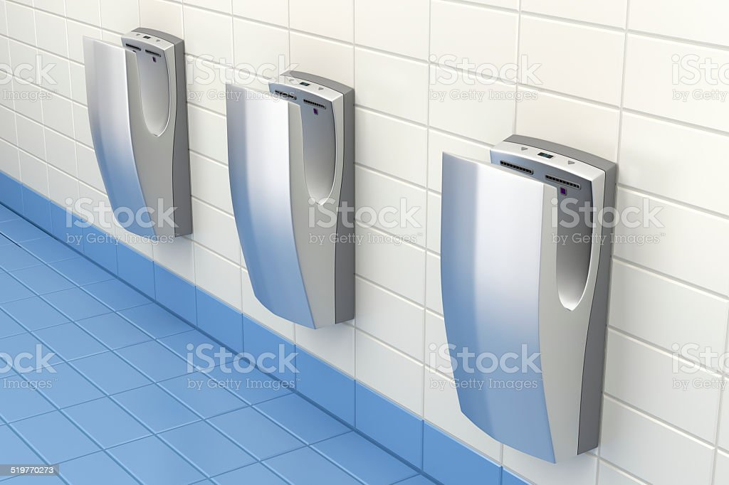 Hand dryers in public washroom stock photo