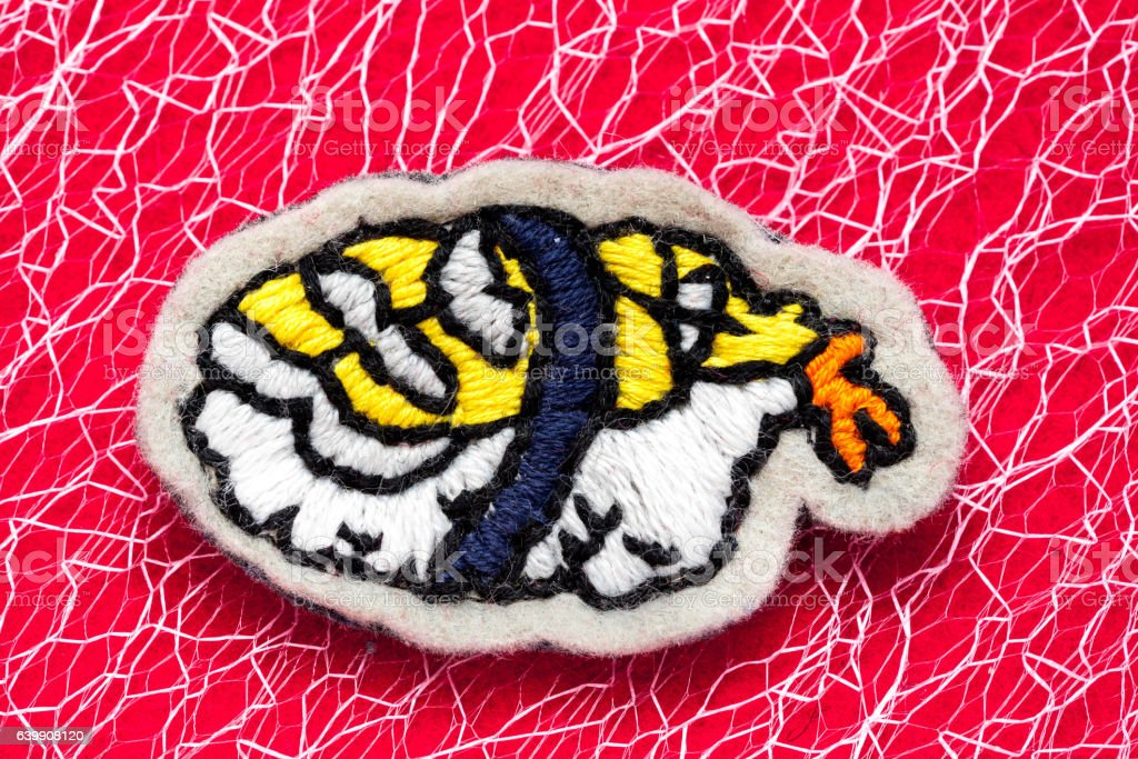 hand embroidered sushi shrimp on a red background stock photo