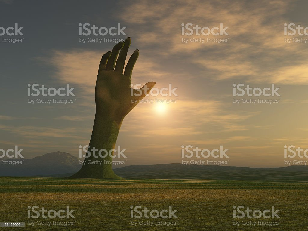 Hand emerging from the earth stock photo