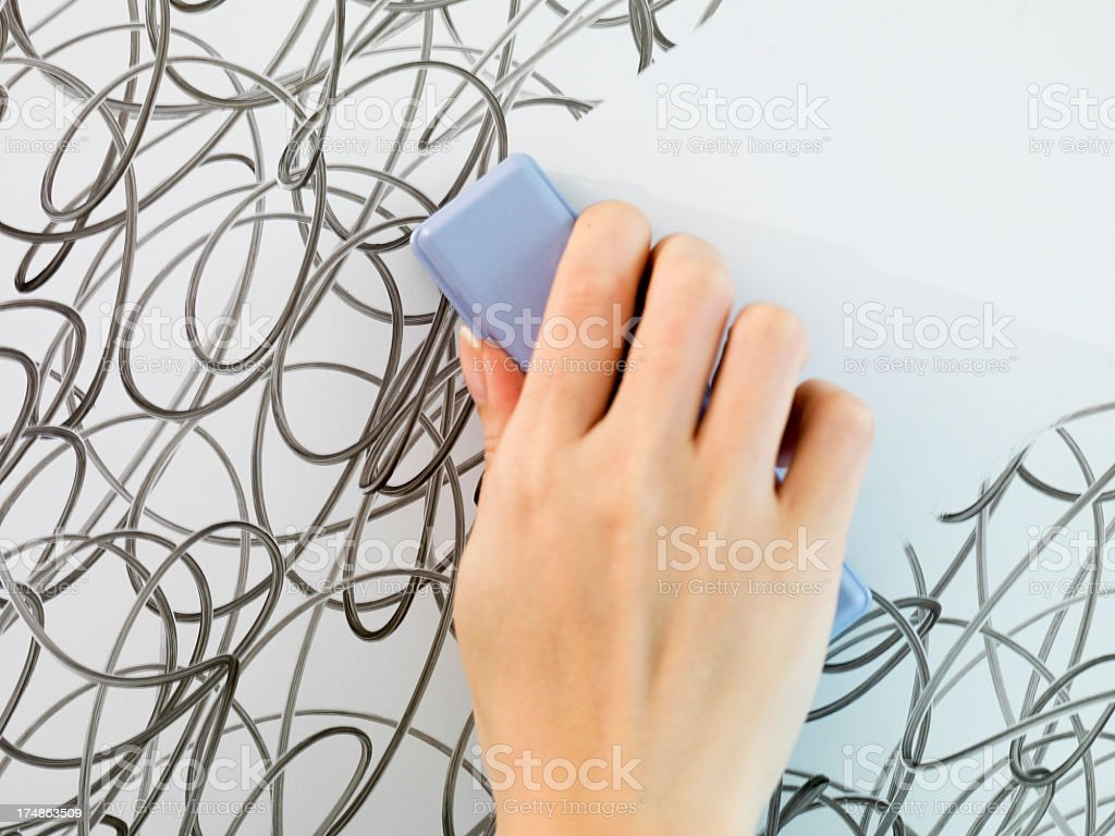 Hand erasing the lines tangled. stock photo