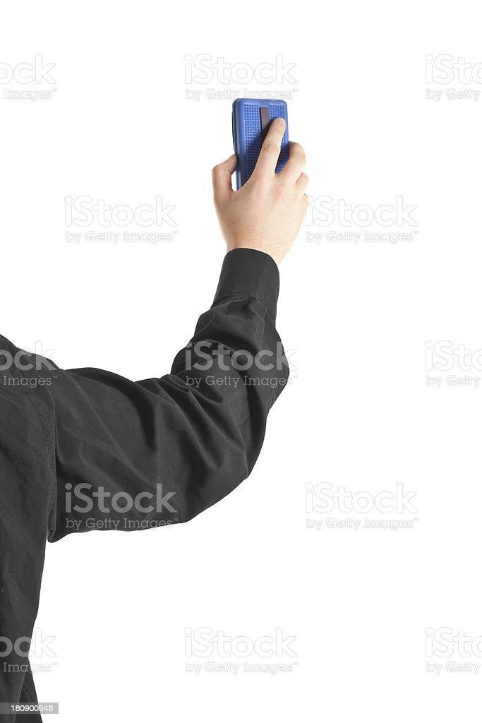 Hand erasing the whiteboard stock photo