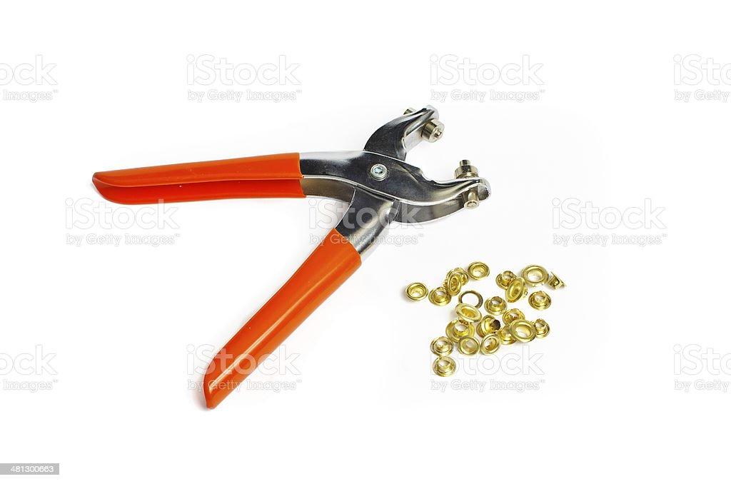 Hand Eyelet Tool and Metal eyelets stock photo