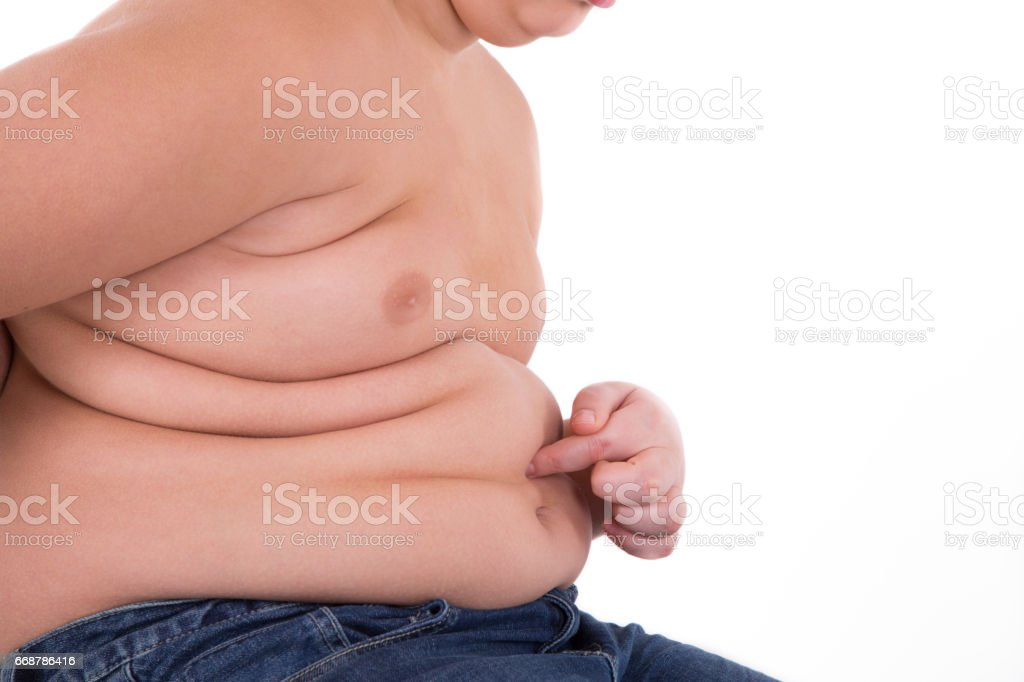 Hand fat boy touch on his belly stock photo