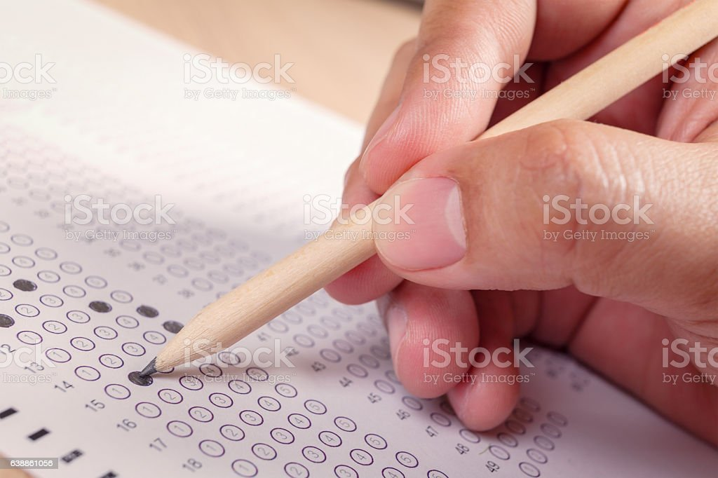 hand fill in Exam carbon paper computer sheet and pencil stock photo