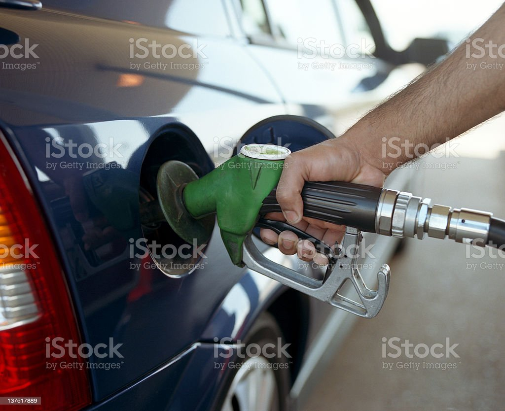 Hand filling car up with fuel pump royalty-free stock photo