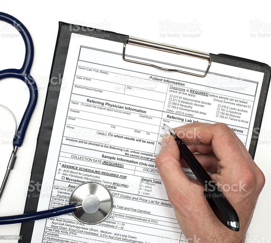 Hand filling in a patient information form  royalty-free stock photo
