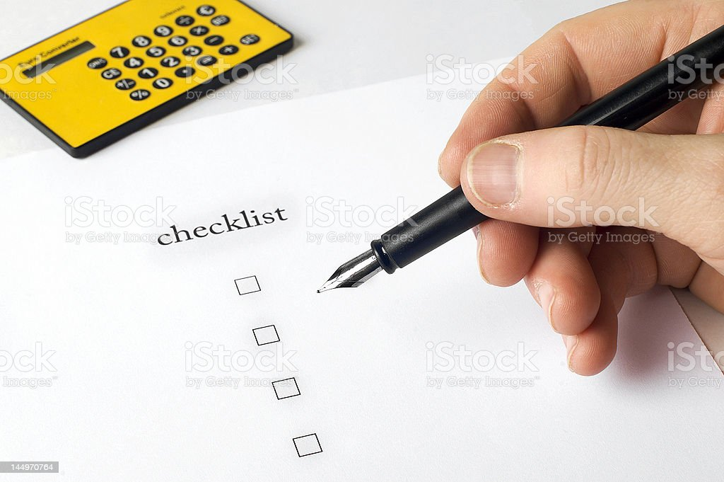 hand filling in Checklist with pen royalty-free stock photo