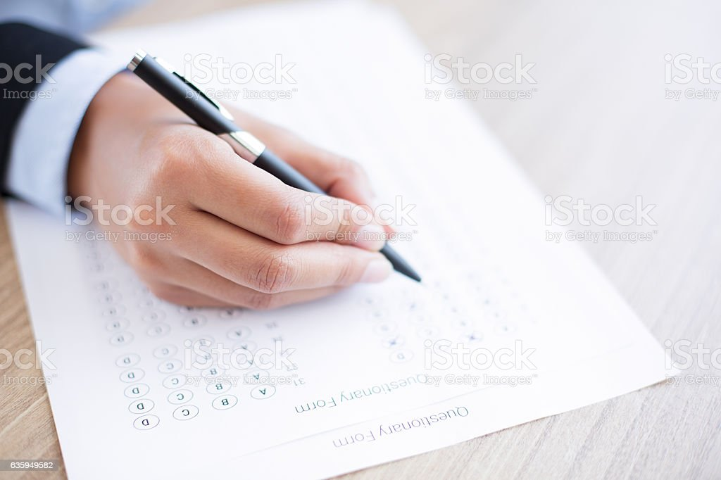 Hand Filling out Questionary Form stock photo