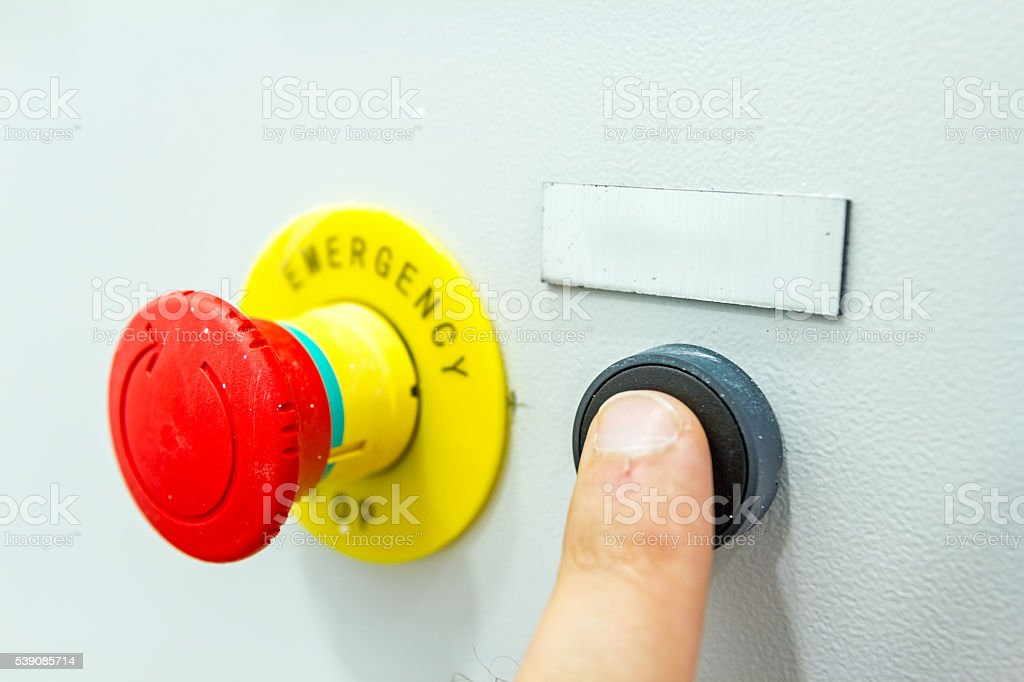 Hand, finger is pushing emergency reset button stock photo