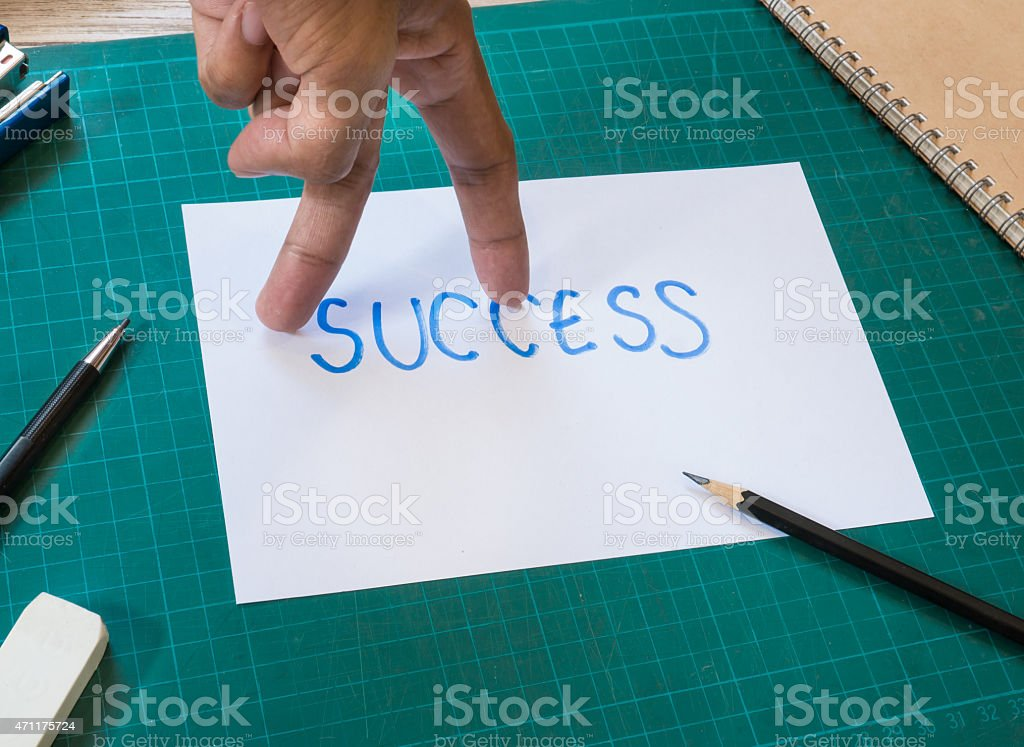 Hand finger look like walking action on success text paper. stock photo